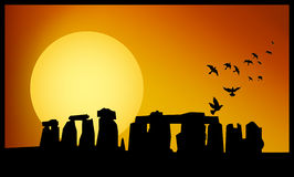 Stonehenge twilight. Stonehenge panorama. Stonehenge at sunset background. Rise birds from Stonehenge Stock Image