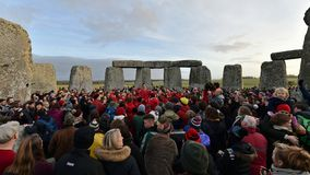 Winter Solstice Celebrations at Stonehenge. Stonehenge, UK - December 22, 2018: Revellers gather at Stonehenge to celebrate the winter solstice stock photo