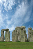 Stonehenge under a blue sky, England. Stonehenge historic site on green grass under blue sky. Stonehenge is a Royalty Free Stock Photo