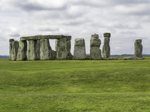 Stonehenge. Under cloudy rainy stormy skies with green grass royalty free stock photos