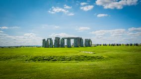 Stonehenge UNESCO Heritage near Salisbury, UK with a line of visitors stock image