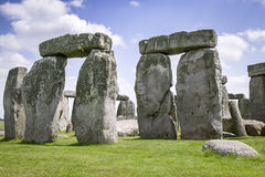 Stonehenge. View of an ancient Monument in rural England with blue cloudy sky Stock Photos