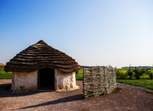 Stonehenge visitors` center. Salisbury planes, england, neolithic wattle and daub reed thatched houses Royalty Free Stock Photos