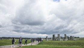 Stonehenge - walking people. This image shows Stonehenge is a prehistoric monument in Wiltshire, England, 2 miles west of Amesbury and 8 miles north of stock images