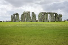 Stonehenge. Warm spring day in stonehenge park. Clouds and sun on green grass stock photos