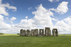 Stonehenge. White fluffy clouds floating in a blue sky over the iconic UNESCO World Heritage Site at Stonehenge, Wiltshire, UK Royalty Free Stock Photo