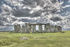 Stonehenge. White fluffy clouds floating in a blue sky over the iconic UNESCO World Heritage Site at Stonehenge, Wiltshire, UK royalty free stock photos