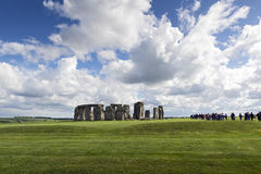 Stonehenge. White fluffy clouds floating in a blue sky over the iconic UNESCO World Heritage Site at Stonehenge, Wiltshire, UK royalty free stock images