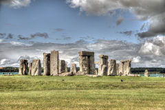 Stonehenge. White fluffy clouds floating in a blue sky over the iconic UNESCO World Heritage Site at Stonehenge, Wiltshire, UK stock photos