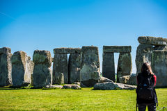 Stonehenge. A young girl looking at the stones in Stonehenge Stock Photos