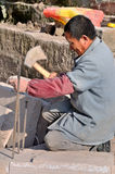 Stonemason in China. Stonemason is cutting stone so that it can be used to pave the way Royalty Free Stock Image