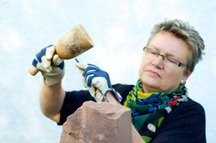 Stonemason in the garden Stock Image