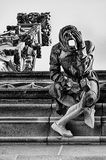 Stonemason Gargoyle on Bern Minster Cathedral. A stone carving of a stone mason in despair and holding a hammer is one of the gargoyles acting as a downspout on Royalty Free Stock Photos