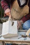 Stonemason. Hands detail of craftsman at work Stock Photo