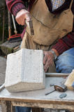 Stonemason. Hands detail of craftsman at work Stock Image