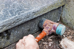 Stonemason knocks riser Stock Photo
