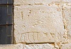 Stonemason marks etched in stone. Santa Maria de Poblet, Cataluña, Spain Stock Image