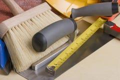 Stonemason's tools. Tools of a stonemason on a gray background Stock Images