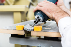 Stonemason shaping ornament with pneumatic chisel Royalty Free Stock Photos