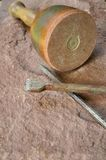 Stonemason tool. Hammer and chisel lying on a sandstone Stock Photography