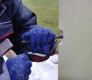 Stonemason at Work. Repairing a damaged World War One Headstone with a Hammer and Chisel Stock Photo