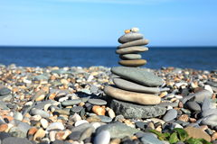 Stones. A stone pile on a pebble beach Royalty Free Stock Images