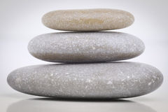 Stones. Pyramid of three stones with reflect. Soft focus Stock Image