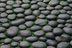 Stones. Gray stones with green moss between stones Stock Photo