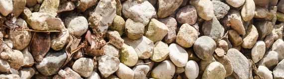 Stones background. Stone decoration on ground in sunlight Stock Photography