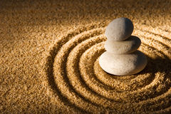 Stones. Three stacked stones on raked sand Stock Image
