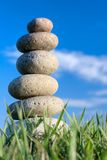 Stones. Round stones lays on grass. Blue sky on a background Royalty Free Stock Images