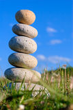 Stones. Round stones lays on a grass. Blue sky on a background Royalty Free Stock Photography