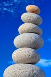 Stones. Round stones on a background of blue sky Royalty Free Stock Images