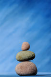 Stones. Vertical image of stone on a blue background Stock Photo