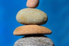 Stones. Horizonta image of stones on a blue background Royalty Free Stock Photography
