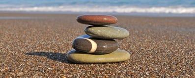 Stones. Pyramid from stones on sea coast Royalty Free Stock Photo