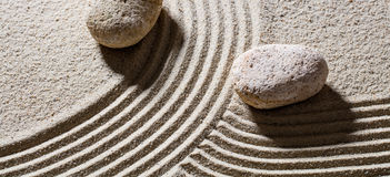 Stones across lines to give different directions for evolution Stock Image
