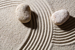 Stones across sand lines for concept of direction and change Stock Image