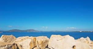 Stones in Alghero harbor Images stock