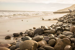 Stones. Along the coast with waves crashing Royalty Free Stock Image