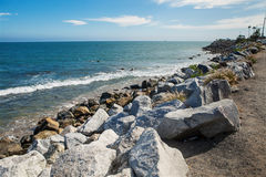 Stones along the rugged coast pacific ocean. Near Malibu, CA. Summer day Stock Photography