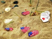 Stones with American flag. At Silver Sands State Park in Milford Connecticut Royalty Free Stock Image