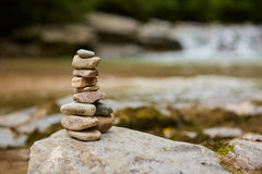 Stones arranged zen-like by the river stock photos