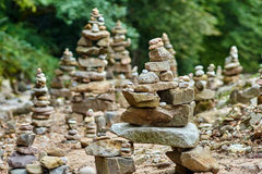 Stones arranged zen-like by the river stock image