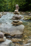 Stones arranged zen-like by the river stock photo