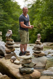 Stones arranged zen-like by the river royalty free stock image