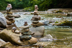Stones arranged zen-like by the river royalty free stock photos