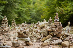 Stones arranged zen-like by the river royalty free stock images