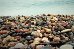 Stones background on beach Stock Image