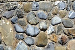 Stones background in gray, white, black, brown and blue hues. Stones of various shapes, forms and colors, background, Tyrrhenian sea, in Livorno, Salivoli royalty free stock images